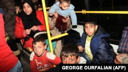 Syrian families from various eastern districts of Aleppo are evacuated by bus on November 27 as Syrian pro-government forces continued their advance toward rebel-controlled districts.