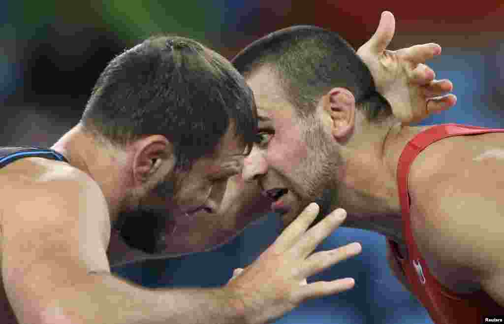 Nikolay Bayryakov of Bulgaria and Javid Hamzatov of Belarus compete in Greco-Roman wrestling final, 85-kilogram division.