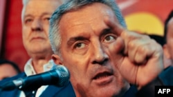 Montenegrin Prime Minister Milo Djukanovic and leader of ruling Democratic Party of Socialists speaks to his supporters after parliamentary elections in Podgorica on October 17.