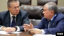 Міністр економічного розвитку Росії Олексій Улюкаєв (ліворуч) та голова компанії «Роснєфть» Ігор Сєчін, Китай, 5 вересня 2016 року
