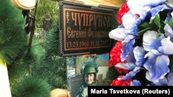A portrait of Russian private military contractor Yevgeni Chuprunov is seen at his grave in Novomoskovsk, in Tula region, Russia June 1, 2017. Picture taken June 1, 2017.