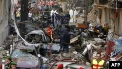 Lebanese security forces and rescue workers gather at the site of an explosion in Beirut on October 19.