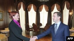 Russian President Dmitry Medvedev (right) shakes hands with newly appointed Agriculture Minister Yelena Skrynnik.