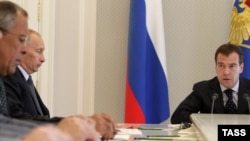 Foreign Minister Sergei Lavrov with Vladimir Putin and Dmitry Medvedev (left to right, in file photo)
