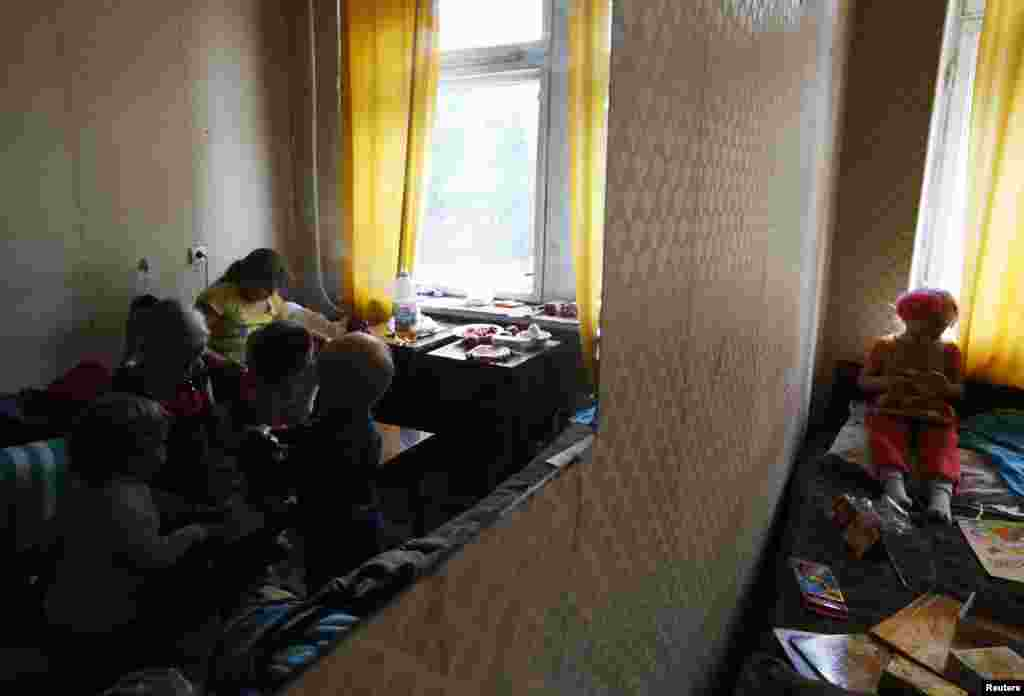 Children of families who have fled from fighting in Slovyansk play with toys at temporary accommodation in a dormitory in the town of Ilovaysk on June 3.