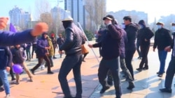 Masked Men Attack Women's Day Rally In Kyrgyz Capital; Police Detain Demonstrators