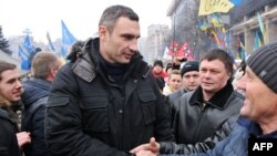 UDAR party leader Vitali Klitschko greets people during a Euromaidan rally at Independence Square in Kyiv in December.