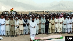 Fellow party members and relatives offer funeral prayers for Habib Jalib in Quetta on July 14