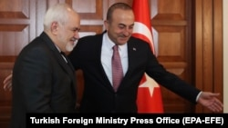 Turkish Foreign Minister Mevlut Cavusoglu (right) meets with Iranian Foreign Minister Mohammad Javad Zarif in Ankara on April 17.