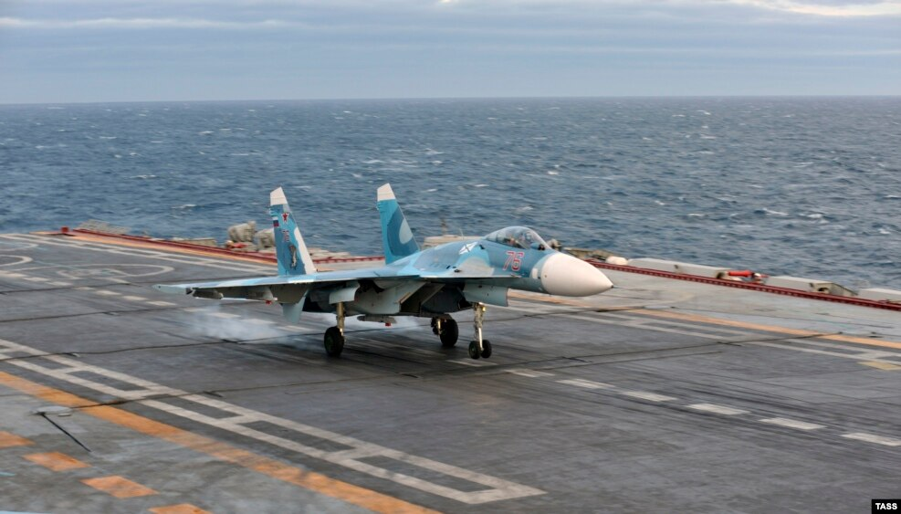 A Sukhoi fighter landing on the deck of the Admiral Kuznetsov. In 2005, a fighter jet plummeted off the end of the carrier after an arresting cable snapped on landing. Both pilots escaped, but the plane plunged into 1-kilometer-deep water.