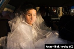 A teenage bride appears deep in thought on her wedding day in 2010.