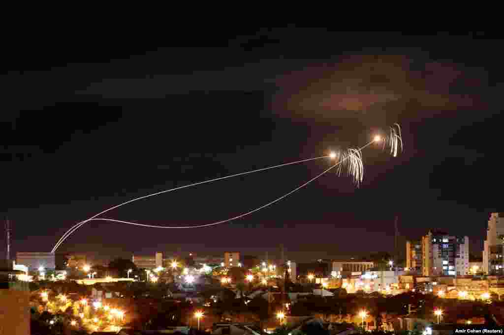 The Iron Dome antimissile system fires interception missiles as rockets are launched from Gaza toward Israel as seen from the city of Ashkelon, Israel, on October 27. (Reuters/Amir Cohen)