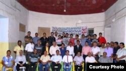 مشاركون في امسية للشعر الشعبي في الكوت