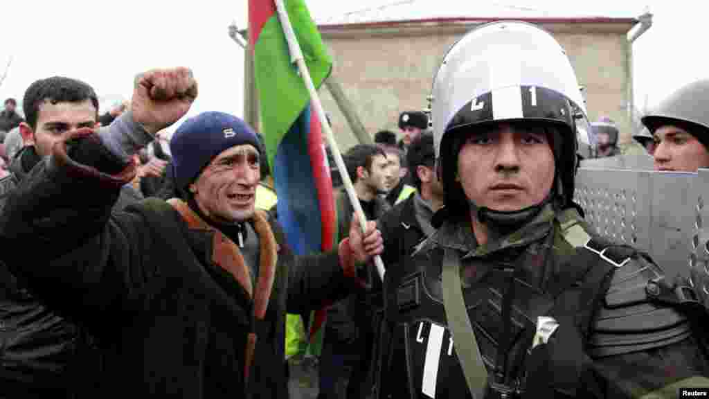 A protester shouts at a policeman during a demonstration in the central square of Quba, Azerbaijan, before a breakout of violence on March 1. (Reuters/Abbas Atilay)