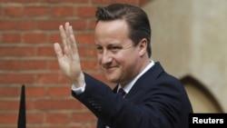 Премьер-министр Великобритании Дэвид Кэмерон в момент прибытия в суд. Лондон, 14 июня 2012 года.