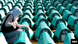 Bosnian Muslim women mourn over a casket at the Potocari Memorial Center during the burial in 2008 of 308 Bosnian Muslims killed by Bosnian Serb forces in Srebrenica.