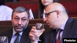 Armenia - Alexander Arzumanian (L) and Khachatur Kokobelian, leaders of the opposition Free Democrats party, at a party congress in Yerevan, 16Mar2012.