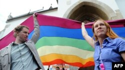 Gay rights activists display a rainbow flag in Zagreb in May, 2013.