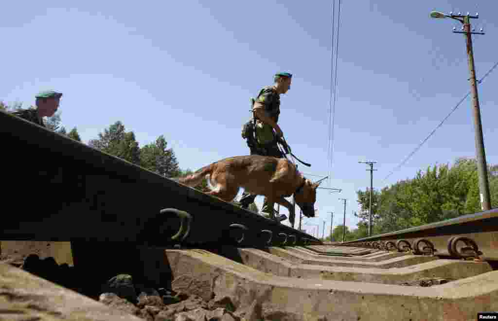 Border guards cross the railways near the Belarus-Poland border on the outskirts of the western city of Brest.