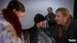 Russian actor Ivan Okhlobystin (right), separatist commander Arsen Pavlov (center), and his wife Yelena attend the premiere of Okhlobystin's latest film in Donetsk in November 2014.
