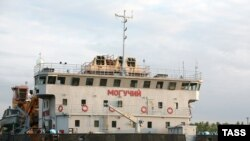 """The """"Moguchiy,"""" a floating crane vessel, leaving the port of Volgograd to lift the sunken """"Bulgaria"""" on July 12."""