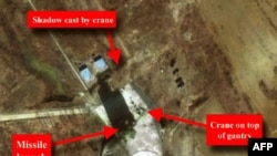 A satellite image from March 26 that was released by The Institute for Science and International Security (ISIS) in Washington and purportedly showing a long-range missile on a launch pad at Musudan-Ri