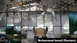 The damaged wedding hall where a suicide bomber struck on August 17, killing dozens of people.