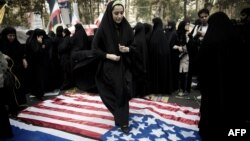 An Iranian woman stamps on a U.S. flag during a protest outside the former American embassy in Tehran in 2013. The Stars and Stripes, however, is not always treated with such contempt in Iran.