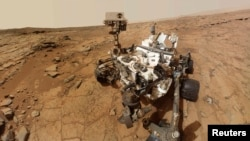 Space -- NASA's Mars rover Curiosity is pictured in a handout self-portrait, 03Feb2013