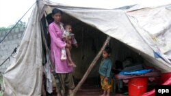 Flood victims forced to live in a temporary shelter in Muzaffarabad in the Pakistani administered Kashmir region