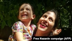 Nazanin Zaghari-Ratcliffe holds her daughter during her three-day release from prison.