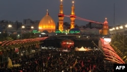Shi'ite Muslim pilgrims gather near the shrine of Imam Abbas as they prepare to celebrate the festival of Ashura in Karbala on November 12. The Ashura celebration is a traditional target of extremist bombings.
