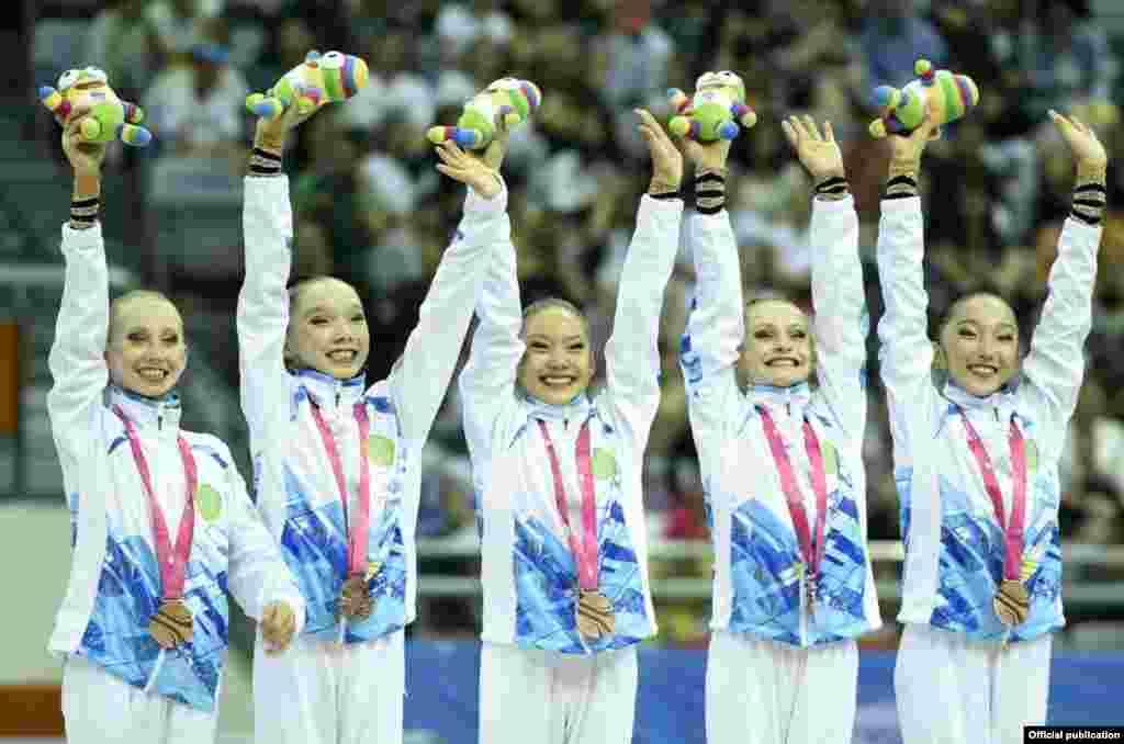 Көркем гимнастикадан Қазақстан командасы топтық жарыста қола жүлдеге ие болды. Нанкин, 27 тамыз 2014 жыл.