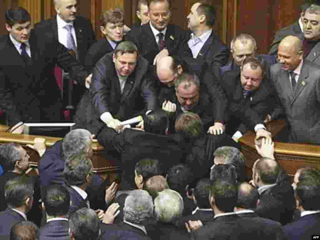 Ukrainian deputies clash during the opening of a new parliament session in Kyiv. - Ukrainian deputies of the pro-Russian Party of the Regions and Communist Party clash with pro-Western deputies of the Our Ukraine bloc and the Yulia Tymoshenko Bloc during the opening of parliament in Kyiv on February 5. Opposition deputies paralyzed parliament in protest against government plans to join NATO.