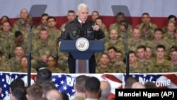 U.S. Vice President Mike Pence speaks to troops in a hangar at Bagram Air Field on December 21.
