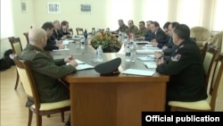 Armenia -- Armenian Defense Ministry officials meet with a visiting NATO delegation, 12Mar2014.