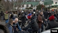 Pro-Russian protesters clash with activists supporting the territorial integrity of Ukraine as Interior Ministry troops attempt to keep them apart during rallies in Kharkiv on April 7.