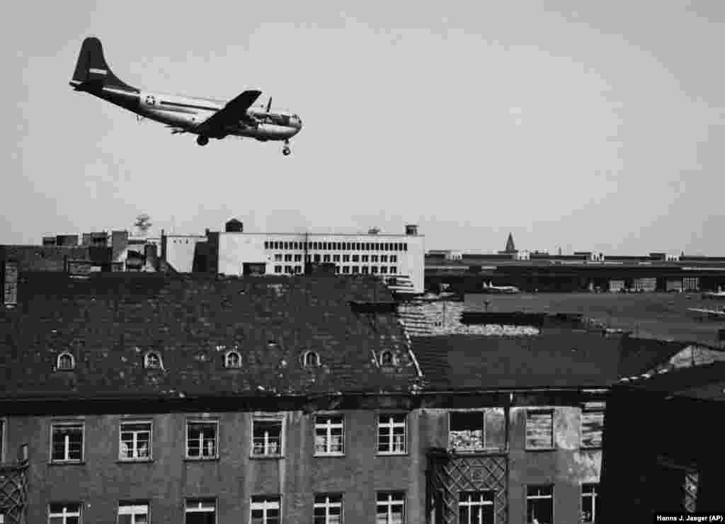 A U.S. Boeing C-97 Stratofreighter approaches Tempelhof over the rooftops of Berlin, coming from Frankfurt am Main, Germany, on May 4, 1949. The plane could carry 25 tons of goods.