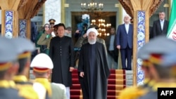 Eýranyň prezidenti Hassan Rohani (s) we Pakistanyň premýer-ministri Imran Han (ç), Tähran, 22-nji aprel, 2019