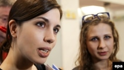 Nadezhhda Tolokonnikova (left) and Maria Alyokhina were convicted of hooliganism and sentenced to two years in jail in 2012 after staging a performance against Russian President Vladimir Putin in Moscow's Cathedral of Christ the Savior.