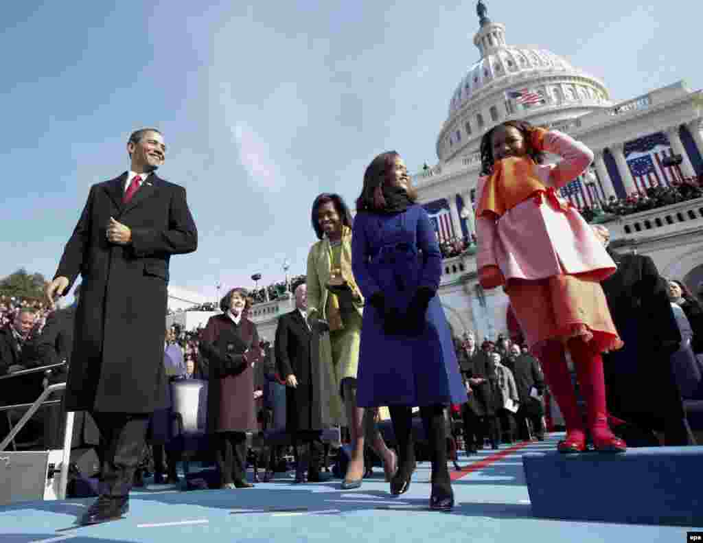 Barack Obama, joined by his wife, Michelle, and their daughters, Malia and Sasha, approaches the podium to be sworn in as the 44th president of the United States in Washington, D.C., on January 20, 2009.