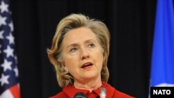 U.S. Secretary of State Hillary Clinton speaks at NATO headquarters in Brussels on December 4