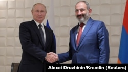 ARMENIA -- Russian President Vladimir Putin shakes hands with Armenian Prime Minister Nikol Pashinian during a meeting on the sidelines of a session of the Supreme Eurasian Economic Council in Yerevan, Armenia October 1, 2019.