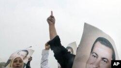 Қаирдің полиция академиясы жанына экс-президент Хосни Мүбәракті қолдаушылар жиналды. 5 қыркүйек. 2011 жыл.