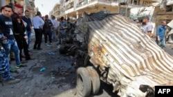 На месте взрыва у моста в Багдаде. 30 мая 2017 года.