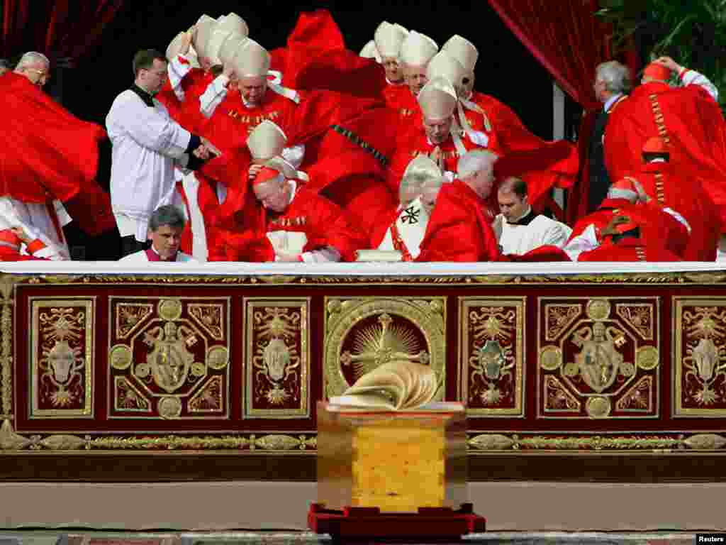 Cardinals' cassocks are blown by a gust of wind as they arrive for the funeral mass of the Pope John Paul II at St. Peter's Basilica in the Vatican, 8 April 2005. REUTERS