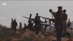 Libyan Rebels Fire On Qaddafi's Hometown