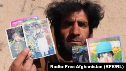 Naqibullah holds up photographs of himself from before he was blinded in 2013 by a landmine explosion.