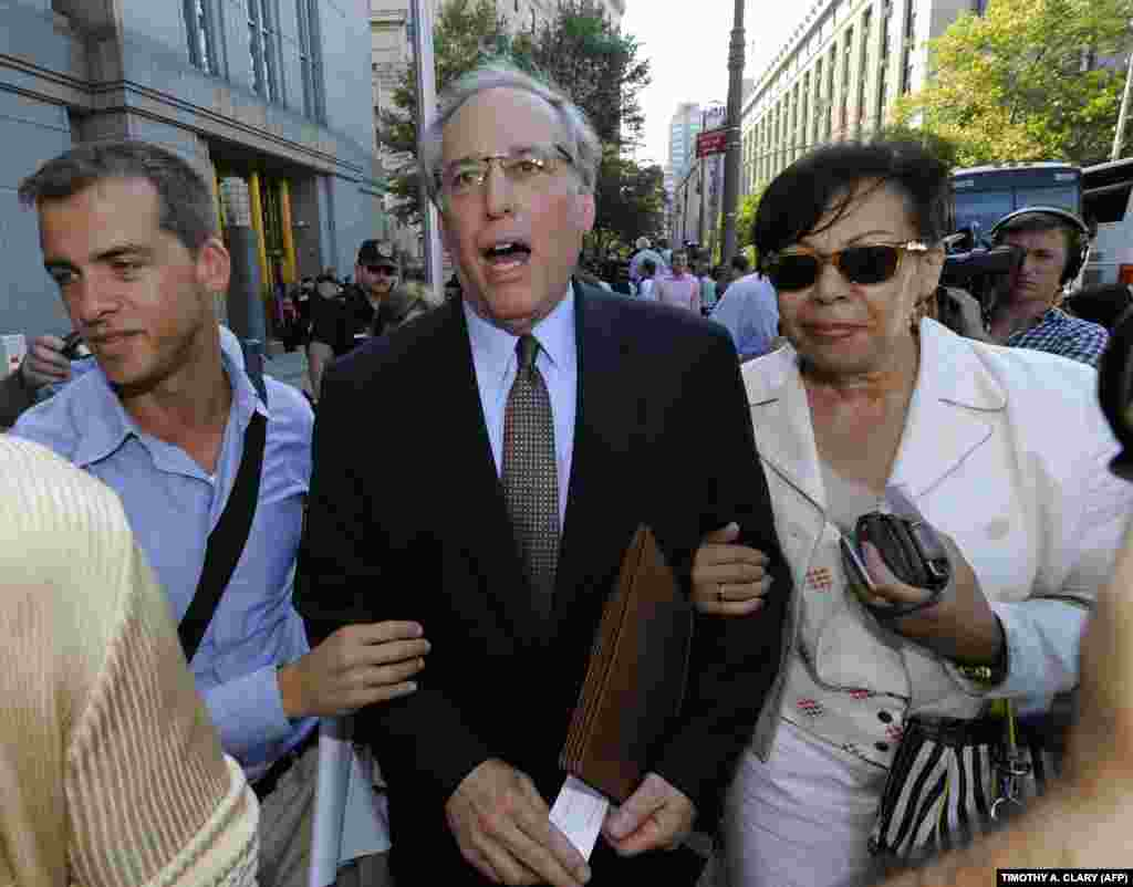 Robert Baum (center), Chapman's lawyer, talks to the press outside Manhattan Federal Court in New York on July 8, 2010, after she pleaded guilty to charges that she communicated with the Russian Federation without registering as a foreign agent.