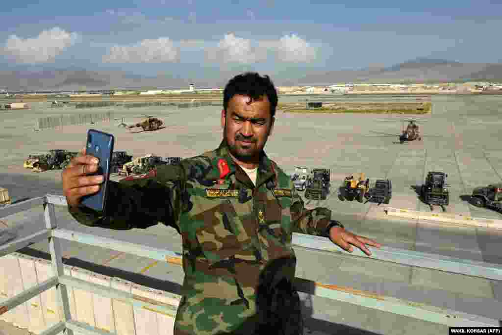 An Afghan National Army soldier takes a selfie inside Bagram Airfield north of Kabul after all U.S. and NATO troops left on July 5.